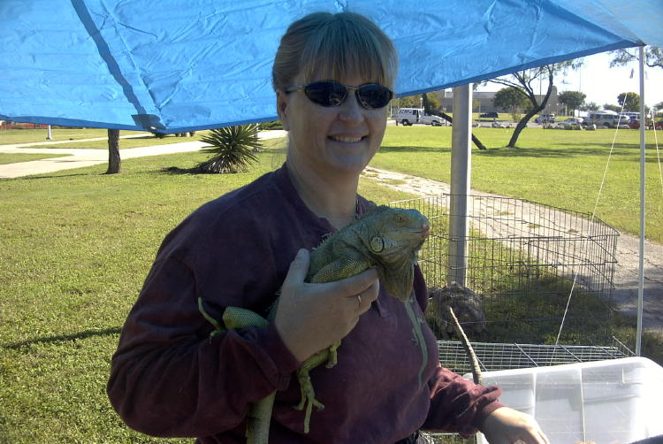Sanctuary Director with Lips the Green Iguana